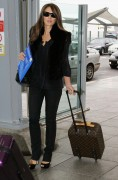 Elizabeth Hurley At Heathrow Airport 9/28/10