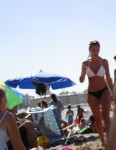 Cazando colas en la playa